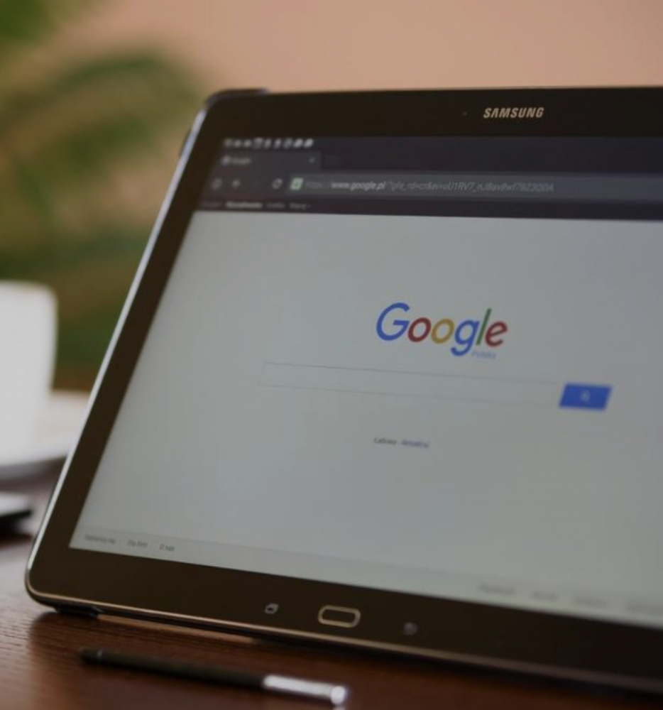 Photo of a laptop open to the Google search